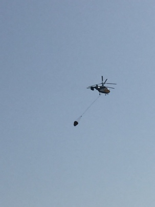 Helicopter flying over villa